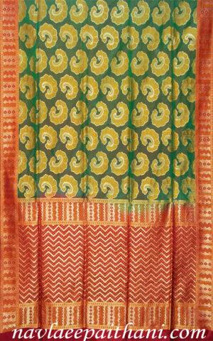 The Green with Maroon contrast boarder in Uppada silk saree.