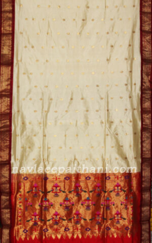 The off white color with contrast maroon boardr in Paithani silk saree.