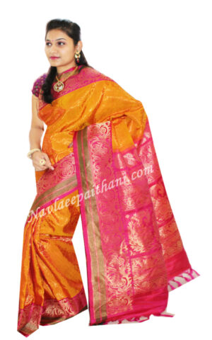 The Golden Yellow color with contrast Pink border in pattu Gadwal silk Saree