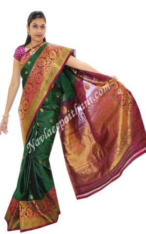 The Green colour with Dark Pink Contrast Boarder in Gadwal Silk Saree.