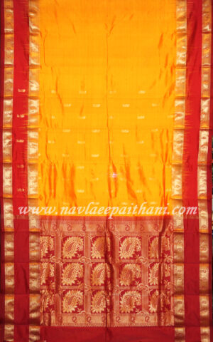 The Mango Yellow with Red Contrast Double boarder in kanjivarum silk saree.