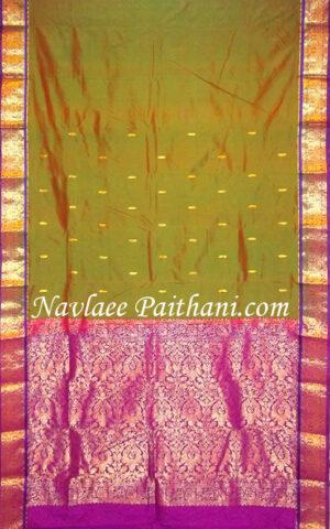 The Two Tone mehandi Green & magenda color with purple border in kanjivaram Silk Saree.