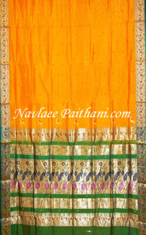 The Yellow Color with Green contrast boarder in Madrai Silk saree.