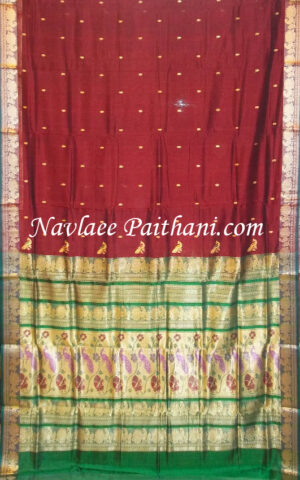 The Brown with Green contrast boarder in Madurai Silk saree.