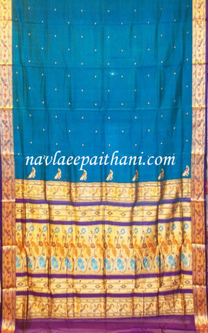 The light blue color with purple contrast boarder in Madurai Silk saree.