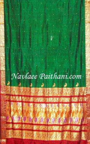 The Green colour with marun contrast boarder in Maurai Silk saree.
