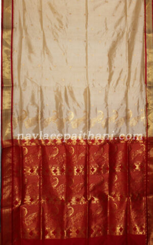 The Pearl White colour with contrast Red boarder in paithani silk saree.